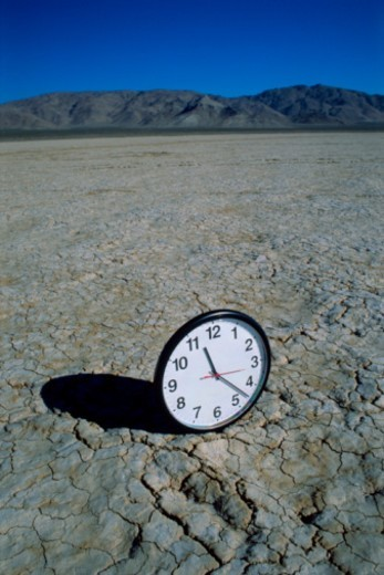 Clock in desert : Stock Photo
