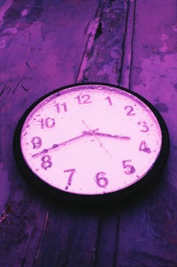 Clock in the rain : Stock Photo