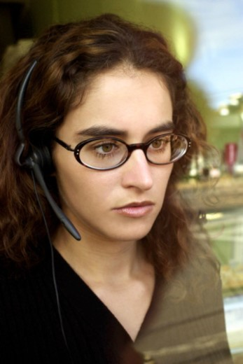 Woman wearing headset : Stock Photo