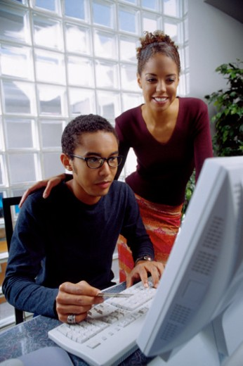Stock Photo: 1557R-312904 Two people working at computer