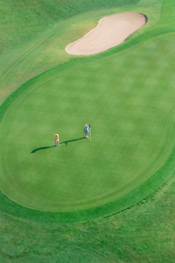 Stock Photo: 1557R-314291 Aerial view of couple playing golf