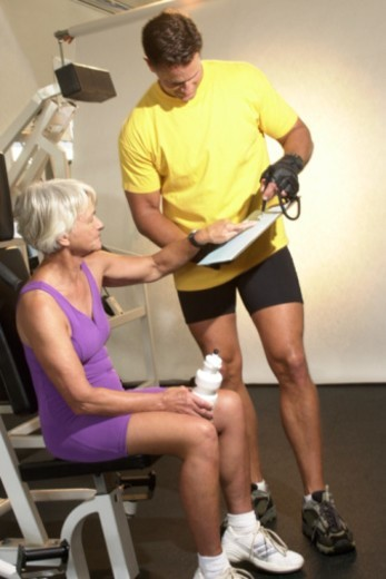 Stock Photo: 1557R-314376 Personal trainer and woman
