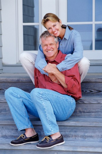 Couple on porch steps : Stock Photo