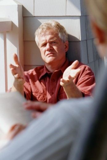 Man talking and gesturing : Stock Photo