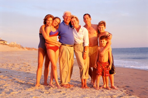Family posing at beach : Stock Photo