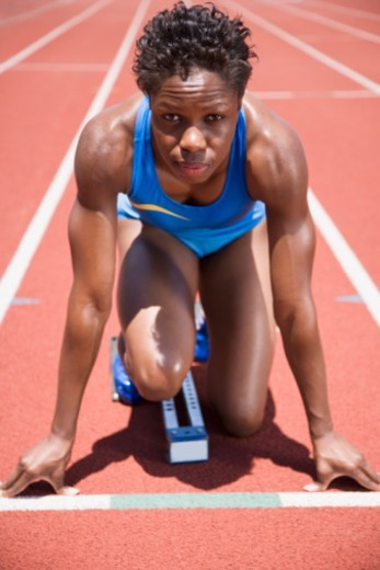 Runner in starting position : Stock Photo