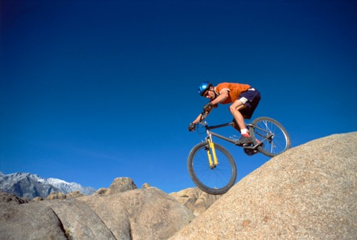 Person mountain biking : Stock Photo