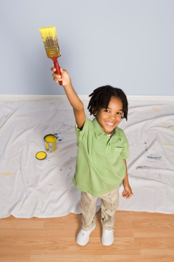Child holding paint brush : Stock Photo