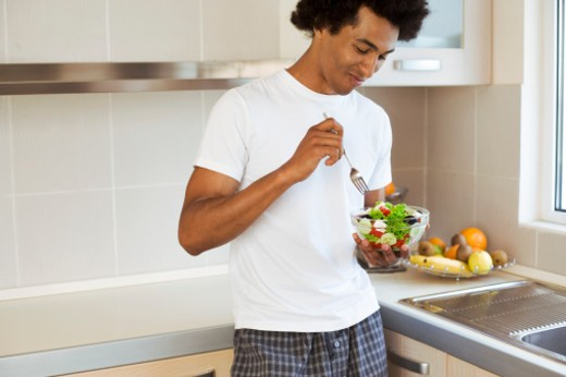 Man eating salad : Stock Photo