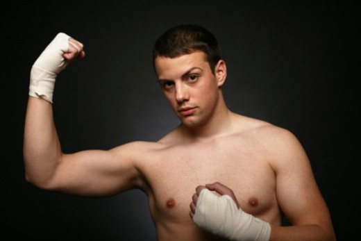 Man boxer with taped hands, flexing : Stock Photo