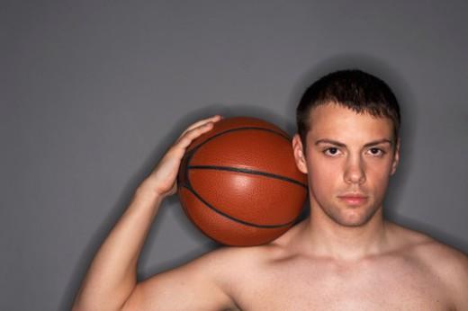 Man with basketball : Stock Photo