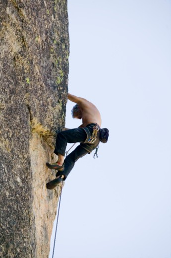 Stock Photo: 1557R-339940 Man rock climbing