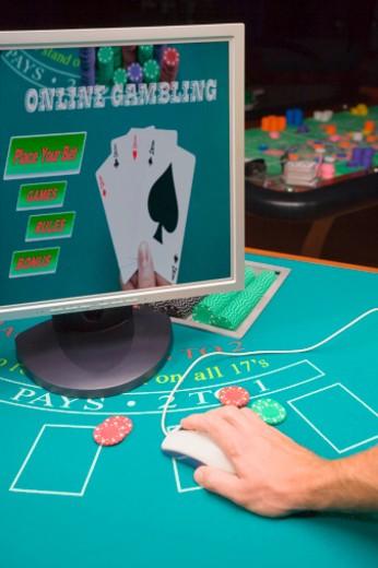 Hand gambling online : Stock Photo