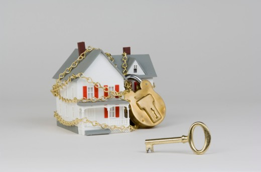 Stock Photo: 1557R-340929 Miniature house with lock and key