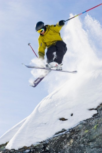 Stock Photo: 1557R-341261 Downhill skier making a jump