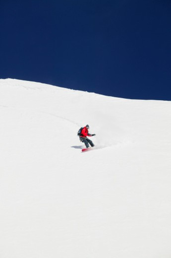 Person snowboarding : Stock Photo