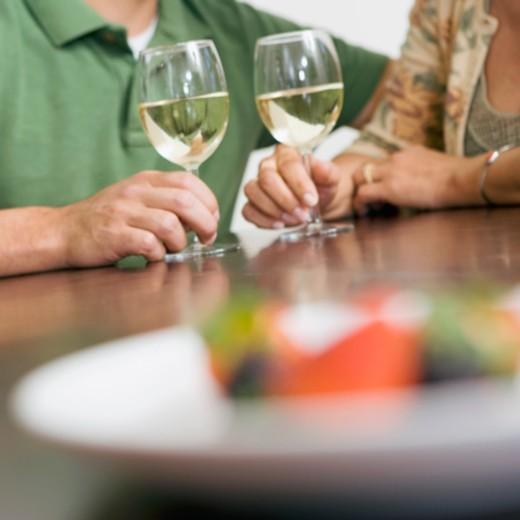 Stock Photo: 1557R-343198 Couple holding white wine