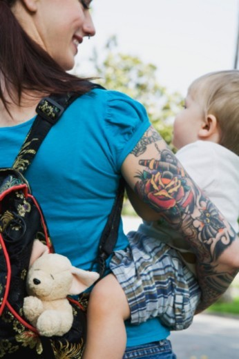 Hipster mother holding toddler : Stock Photo
