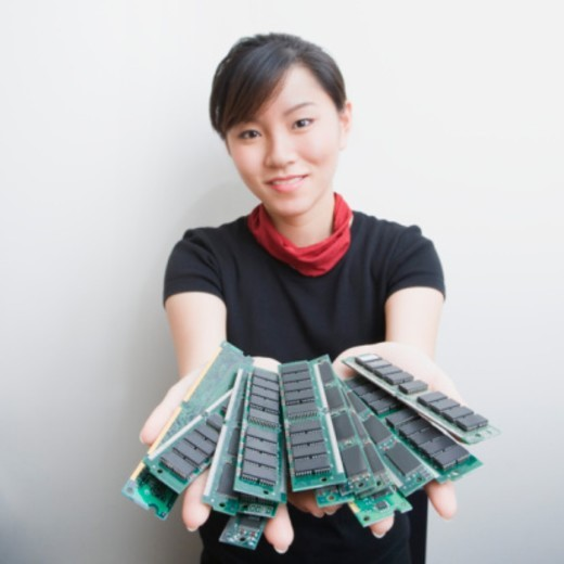 Woman holding memory chips : Stock Photo