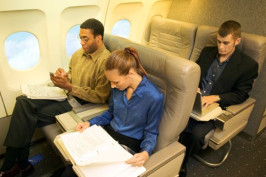Stock Photo: 1557R-351111 Business travelers working on airplane