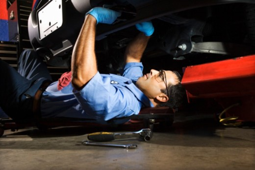 Auto mechanic fixing vehicle : Stock Photo