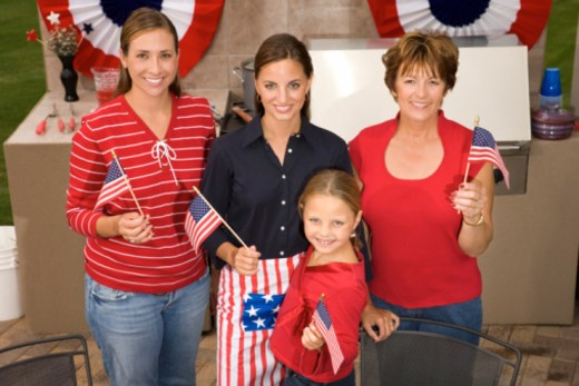 Women posing with American flags : Stock Photo