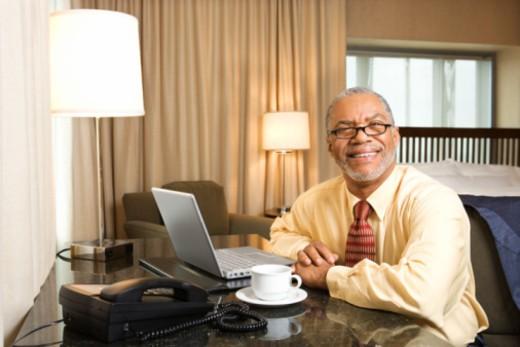 Businessman posing in hotel room : Stock Photo