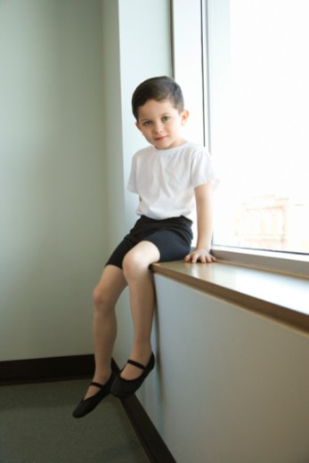 Boy in ballet class sitting in window : Stock Photo
