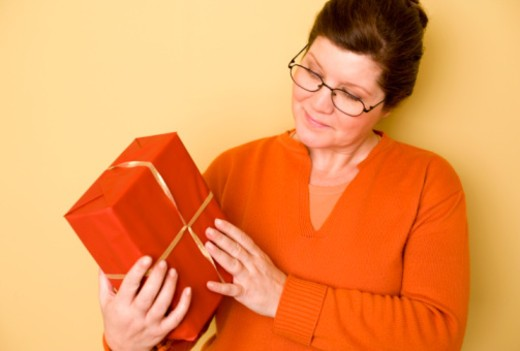 Woman with present : Stock Photo