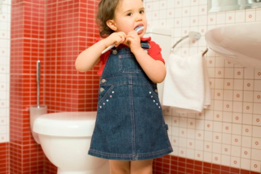 Girl brushing teeth : Stock Photo