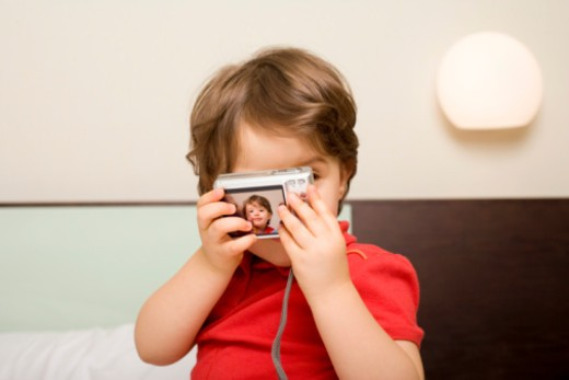 Child with camera : Stock Photo