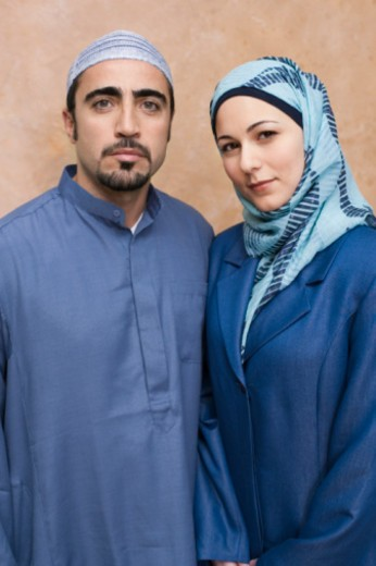 Turkish man wearing thobe and Iranian Persian woman wearing hijab headscarf : Stock Photo