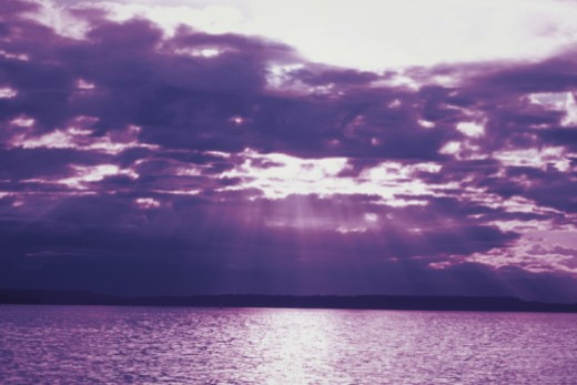 Stock Photo: 1557R-352499 Sunlight shinning through clouds onto ocean