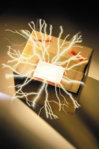 Lightning bolts emanating from a package : Stock Photo