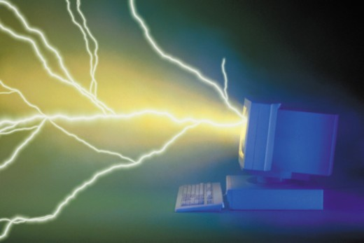 Lightning bolt emanating from computer monitor : Stock Photo