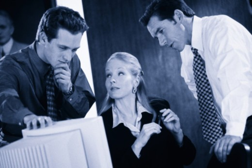 Stock Photo: 1557R-353400 Businesspeople solving problem