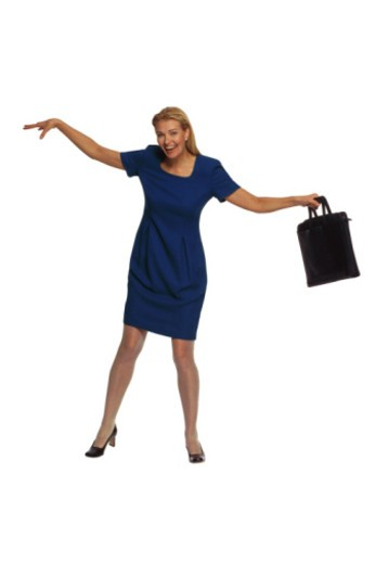 Businesswoman with briefcase posing : Stock Photo