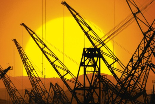 Stock Photo: 1557R-353471 Cranes in sunset