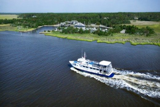 Stock Photo: 1557R-355270 Aerial view of boat near shore, Bald Head Island, North Carolina
