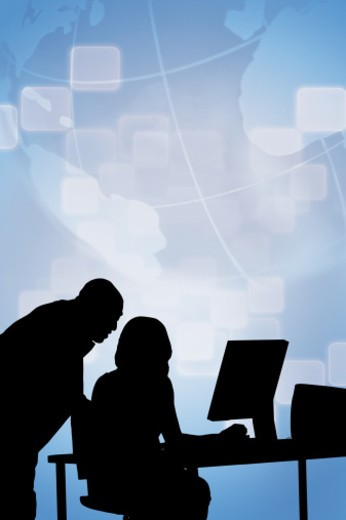 Silhouette of businesspeople working against map : Stock Photo