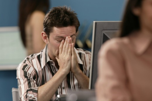 Stressed man at computer : Stock Photo