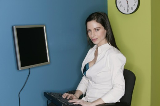 Stock Photo: 1557R-355842 Businesswoman with blouse unbuttoned