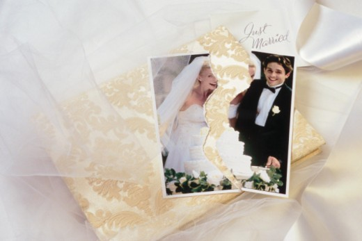 Torn wedding photo symbolizes divorce : Stock Photo