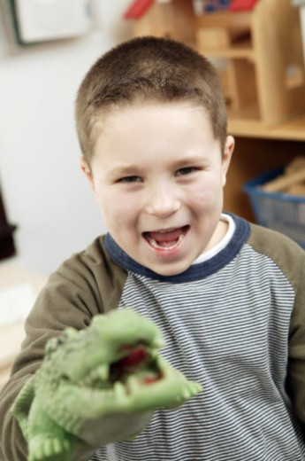 Stock Photo: 1557R-356266 Boy with alligator puppet