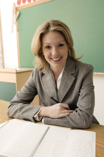 Teacher with grade book : Stock Photo