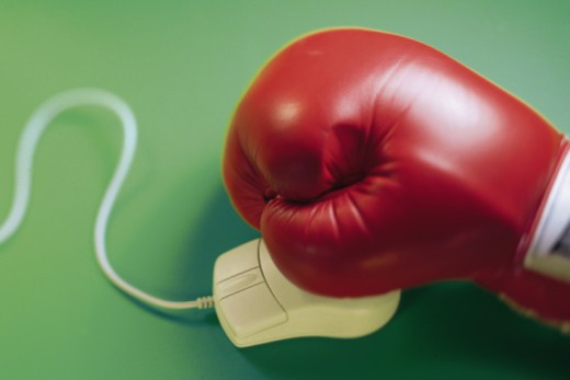 Stock Photo: 1557R-356795 Boxing glove with computer mouse