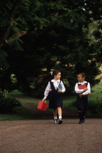 School girls in uniform walking : Stock Photo