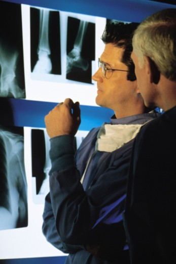 Medical professionals examining x-rays : Stock Photo