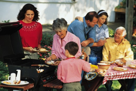 Family at backyard barbecue : Stock Photo