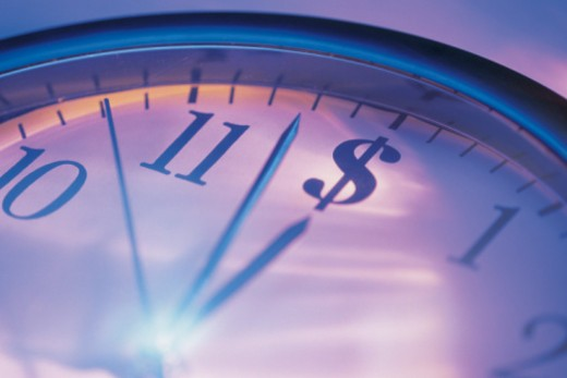 Clock with dollar sign in twelve o'clock position : Stock Photo